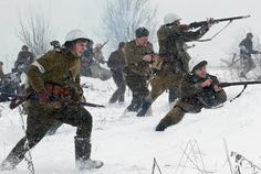 """KRASNOYE SELO, ST PETERSBURG, RUSSIA - JANUARY 15, 2017: Participants in a historical re-enactment of a WWII battle for the town of Krasnoye Selo titled """"For Leningrad! Liberation of Krasnoye Selo."""" The battle was a part of the Krasnoye Selo-Ropsha Offensive on the Eastern Front of World War II."""