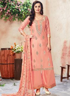 Desirable Chanderi Peach Embroidered Work Designer Palazzo Suit  Style and trend will be at the peak of your beauty when you attire this peach chanderi designer palazzo suit. Beautified and stylized with embroidered and resham work to give you an attractive look. Comes with matching bottom and dupatta.