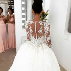 The back of this long sleeve bridal gown is stunning! Let us create a custom wedding gown like this for you. We are dress makers from the USA who offer brides on a budget affordable custom #weddingdresses made the way they want them. We also can make a very similar replica of any dress based on a picture. Contact us directly for pricing.