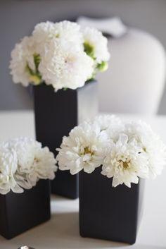 White mums in black vases