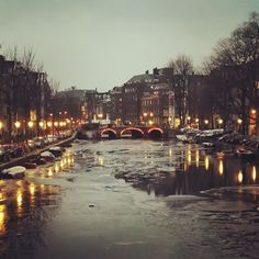 Cold Warmth - On february 2018 the canals in Amsterdam were frozen. This shot was the day the ice started to melt.