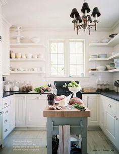 white cabinets / black countertops / white open shelves / white subway tile + colorful island