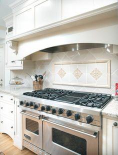 Black counter top white brick traverteen splash antiqued ivory tile backsplash white cabinets - Stunning backsplash designs for behind ranges ...