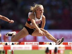 Brianne Theisen-Eaton runs a 12.98 in the heptathlon 100-meter hurdles during the IAAF World Championships. Kirby Lee, USA TODAY Sports