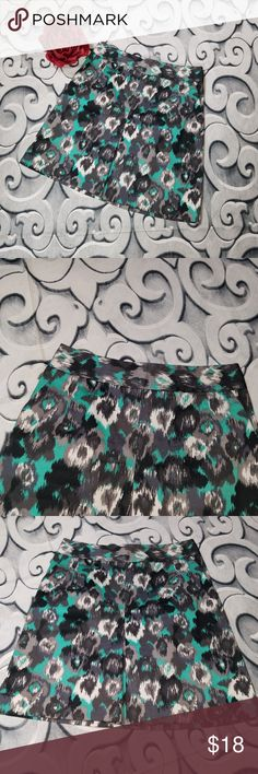 """3/$20 A-Line Skirt Abstract Print Express Design Studio A-Line Skirt Abstract Print Size 6  Measurements: Waist: 28"""" Length: 19""""  Flower not included  Inventory Number: 89 Express Skirts A-Line or Full"""