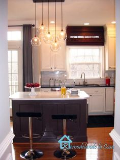 Kitchen with gray walls paint color, Carrera Marble Tile Backsplash, Quartz Countertops, Firefly Pendant Light. Benjamin Moore Navajo White and Tudor Brown