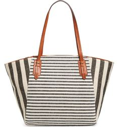 This roomy, mixed-stripe tote in a lightly structured trapeze silhouette is topped with easy over-the-shoulder handles and features a flat base for stability.