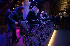 nteractive bicycle and light artwork by joost van bergen, dirk schlebusch and onne walsmit of venividimultiplex illuminates a passage of the rijksmuseum in the netherlands.