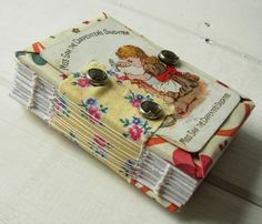 Journal made with playing cards. I have decks of old souvenir playing cards. Could do this to save them!