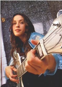 Alanis Morissette is another artist loved by my mom. I use to always sing Hand in my pocket to her. She loved it (: