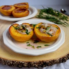 Peaches roasted in honey recipe and topped with a delightful cinnamon infused mascarpone filling garnished with tarragon and pistachios