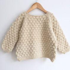 Knitted kid sweater with Bubble Stitch Pattern. Free knitting pattern.