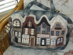 http://www.craftsy.com/pattern/quilting/accessory/the-dutch-townhouses-bag--iphone-cosy/145396