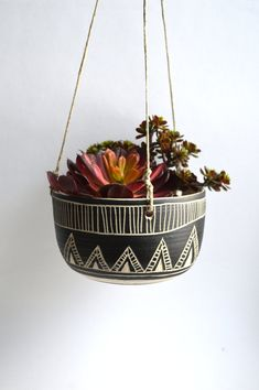 This hanging planter is wheel thrown and hand carved. This listing is made to order. will ship in 2-4 weeks.