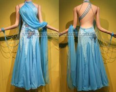 Move the front draping thingie to the back and pin it at the hip.