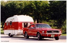 1966 SMV 12 camper with a 1968 Mustang;today's mustangs just won't look right pulling one!