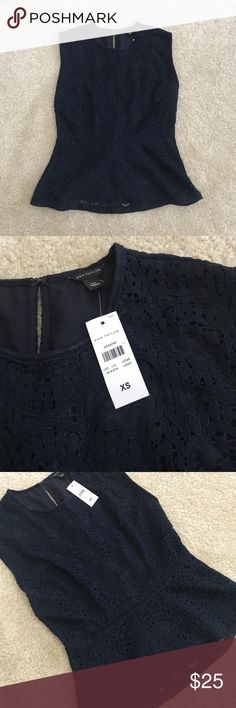 Ann Taylor Navy Lace Peplum Top Ann Taylor top with Lace overlay / Zip and clasp closure in the back / Peplum style and very comfortable / New with the tag and never been worn. About 65% off! Ann Taylor Tops Tank Tops