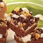 Rocky Road Bars - Brownie-like chocolate bars are smothered with marshmallows, walnuts and chocolate chips to make these chock-full treats.