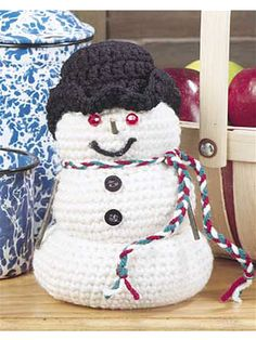 Snowman  This smiling snowman has a secret! When you lift up his top half, you'll find a hiding place for sweets or small gifts.  Designed by  Cathleen Hawks
