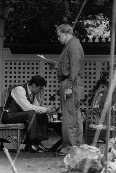 The Godfather - Al Pacino and Marlon Brando going over the script on set #GangsterMovie #GangsterFlick
