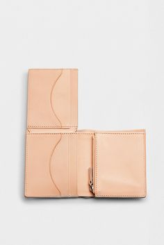 The Lennert travel wallet contains seven card slots, two slip pockets, and a zip coin pocket.
