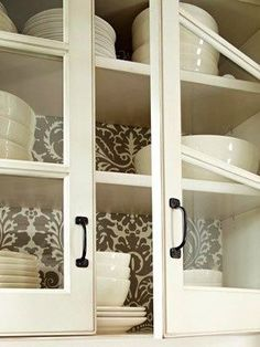 Wallpaper behind shelves: subtle but makes a statement. Awesome! I saw this on a design show! You can also use wrapping paper (etc.) glued to cardboard and fitted in the space so you can change it at any time! (good for bookshelves as well!).