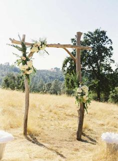Simple wedding arch, I like the locations of flowers