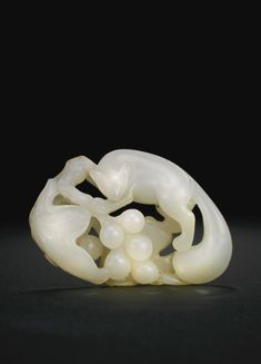 A WHITE JADE 'SQUIRREL AND GRAPES' CARVING<br>QING DYNASTY, 18TH / 19TH CENTURY | lot | Sotheby's
