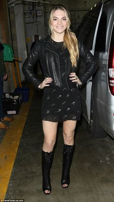Quick change: As she arrived at Topshop, the blonde was sporting a more casual, floral-pri...