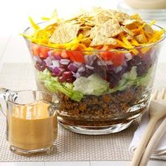 Potluck Taco Salad Recipe- Recipes I found this recipe in an old school cookbook, and I've taken it to many potlucks since then. The layers look so pretty in a glass bowl.Sandy Fynaardt, New Sharon, Iowa Taco Salad Recipes, Taco Salads, Potluck Recipes, Home Recipes, Mexican Food Recipes, Beef Recipes, Great Recipes, Cooking Recipes, Taco Salad Doritos