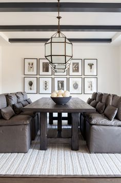 Modern Farmhouse Dining Room with leather dining chairs The leather dining chairs are RH Cloud Dining Leather Side Chair, The chairs harmonize with a reclaimed-wood dining table and a series of botanical prints by German photographer Karl Blossfeldt #ModernFarmhouse #DiningRoom Chango & Co
