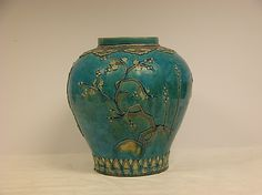 Porcelain with white and aubergine enamels on turquoise ground, Jiajing period (1522–66) , Ming dynasty (1368–1644 AD).