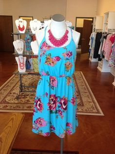 Summery floral dress and jewelry at Gigi's Boutique!