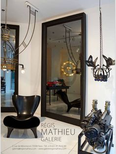 Ancient mechanical clocks, car engines and chandeliers at Regis Mathieu Gallery in Paris