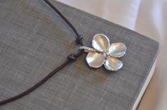 Sterling Silver Flower on Leather - Necklace by CopperfoxGemsJewelry on Etsy https://www.etsy.com/listing/128353572/sterling-silver-flower-on-leather