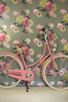 floral wall and pink vintage bike. the dream.