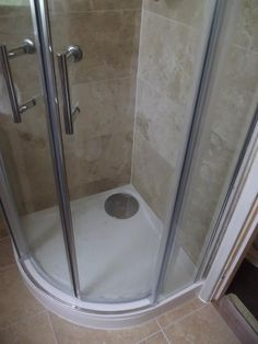 The bathroom was large enough to accommodate a separate shower cubicle. This is an 800mm quadrant cubicle.  http://www.ppmsltd.co.uk
