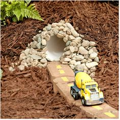The city even has a tunnel for the cars to drive through, which is simply PVC pipe covered by mulch. Also, cement blocks painted and buried to create the roadway. (look out for spiders and snakes that may take up shelter in the pipe!)