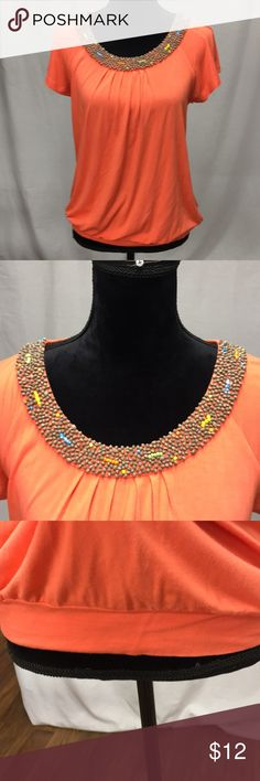 cable & gauge top So cute cable & gauge top with beautiful wooded beads adorning neckline and band around waistline. In like new condition. Coral in color Cable & Gauge Tops