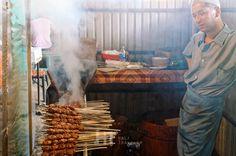 Preparing Shashlik kebab in the old bazaar of Osh, Kyrgyzstan.
