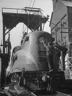 Workman Overhauling Pennsylvania Electric Locomotive in Rail Yard at Union Station Premium Photographic Print by Alfred Eisenstaedt at AllPo...