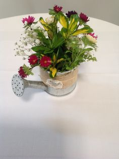 wattering can flowers