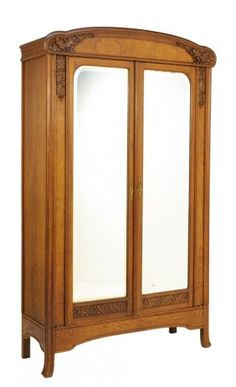 A FRENCH ART DECO STYLE OAK ARMOIRE WITH CARVED ACORNS : Lot 157