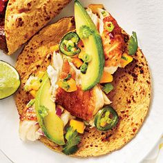 Cumin-Spiced Fish Tacos with Avocado-Mango Salsa by My Recipes. Taco night will never be the same once Cumin-Spiced Fish Tacos are on the menu. The citrus flavors of the Avocado-Mango Salsa complement the fish extremely well. Seafood Recipes, Mexican Food Recipes, Cooking Recipes, Healthy Recipes, Entree Recipes, Healthy Tacos, Recipes Dinner, Carnitas, Tortilla Chips