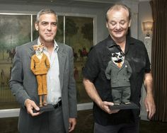"George Clooney (Mr. Fox) & Bill Murray (Badger) holding their characters - ""Fantastic Mr. Fox"""