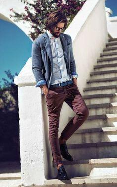 burgundy jeans, a light blue shirt and a grey jacket