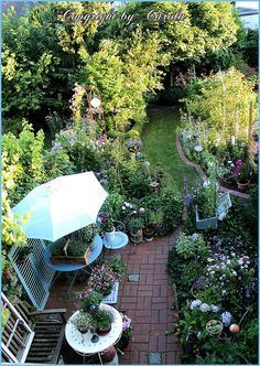 A new birdseye view of my small row cottage garden by Boxwoodcottage, via Flickr