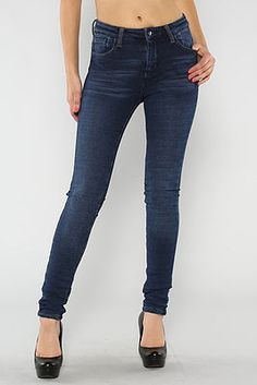 Solid denim knit jeggings with button and zipper closure at waist.  60% Cotton / 31% Polyester / 9% Spandex  Hand Wash Cool / Tumble Dry