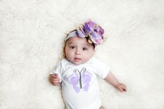 Luc&Lou Butterfly Onesie. Your precious girl will be looking pretty Butter-FLY in this trendy onesie. As every little fashionista knows…purple is the new black! For every onesie purchased, another onesie is donated to a baby in need. www.lucandlou.com #2babies2smiles #lucandlou #nicugrad #onesies @onesie #gift #toddler #oneforone #butterfly #footprint #babyshower