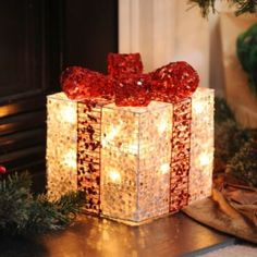 Let your holiday spirit sparkle with our Pre-Lit Silver Glitz Gift.